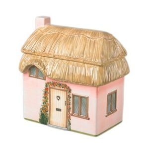 Ceramic pink cottage with removable roof lid